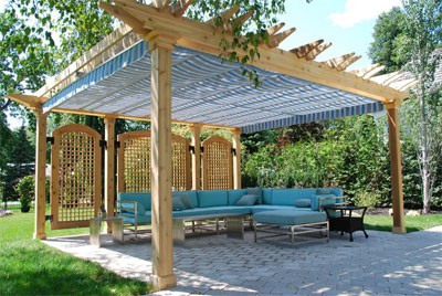 Pergola with Blue Canopy Over Sectional Sofa